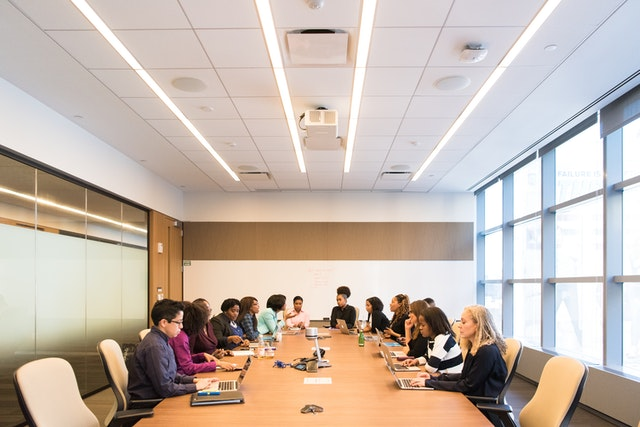 group-of-people-in-conference-room-1181304